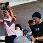 Kassie Gile receiving her surfing trophy