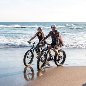 Happy Couple Fat Biking on Lincoln City Beach
