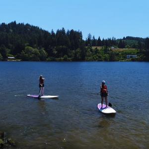 Ladies Paddle Boarding Devils Lake Oregon